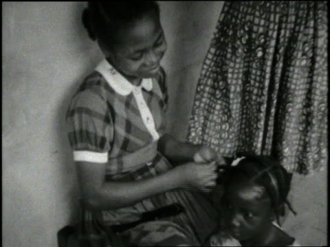 a girl braids the hair of a friend - plaits stock videos and b-roll footage