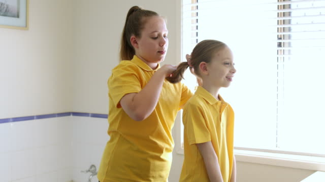 girl brushing sisters hair - brushing hair stock videos & royalty-free footage