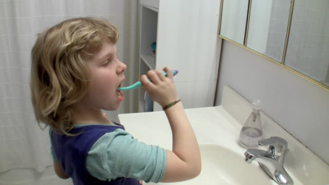 ms girl (6-7) brushing teeth / brooklyn, new york, usa - brushing teeth stock videos & royalty-free footage