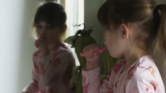 cu tu td girl (4-5) brushing teeth in bathroom / cedar hills, utah, usa - brushing teeth stock videos & royalty-free footage