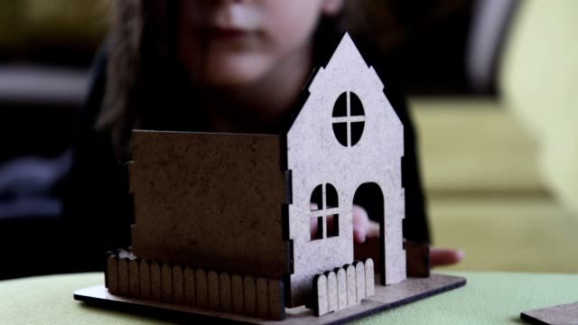 girl building model home - show home stock videos & royalty-free footage