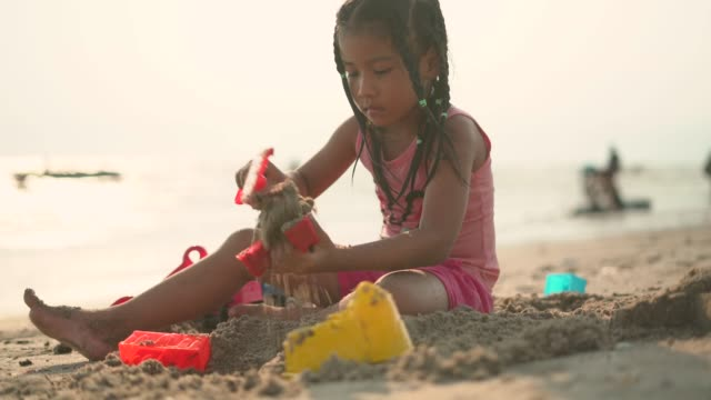 a girl building the sand castle at beach - shovel stock videos & royalty-free footage