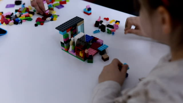 Girl building with toy cubes