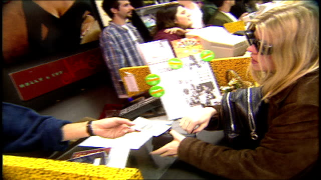 girl buying cds at tower records in los angeles, california - tower records stock videos & royalty-free footage