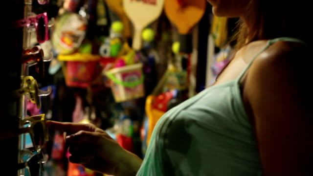 girl buys souvenirs on the street