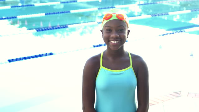 girl by pool wearing swimming goggles and cap - swimming cap stock videos & royalty-free footage
