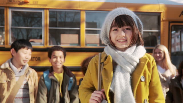 girl by school bus - primary school child stock videos and b-roll footage