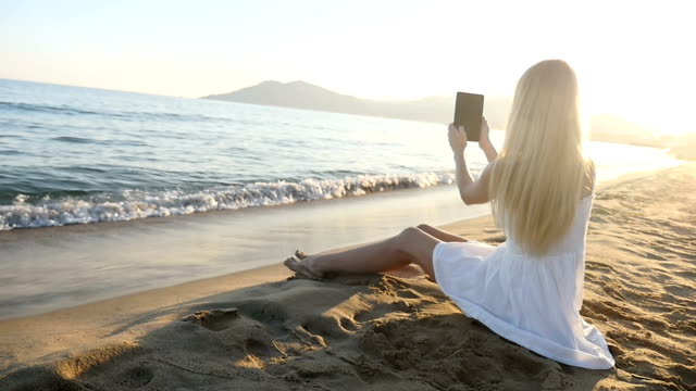 girl capturing an image of sea horizon - horizon over water stock videos & royalty-free footage