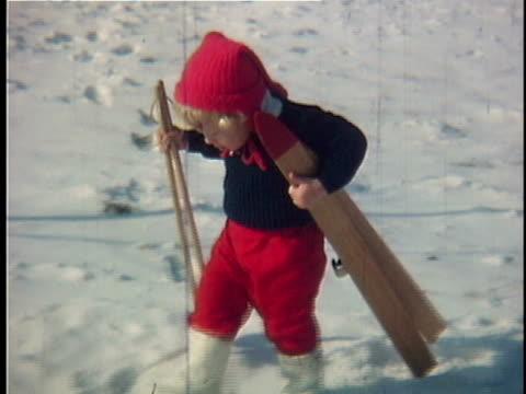 vídeos de stock e filmes b-roll de 1963 ms composite girl (2-3) carrying skis on snow, vermont, usa - bastão de esqui
