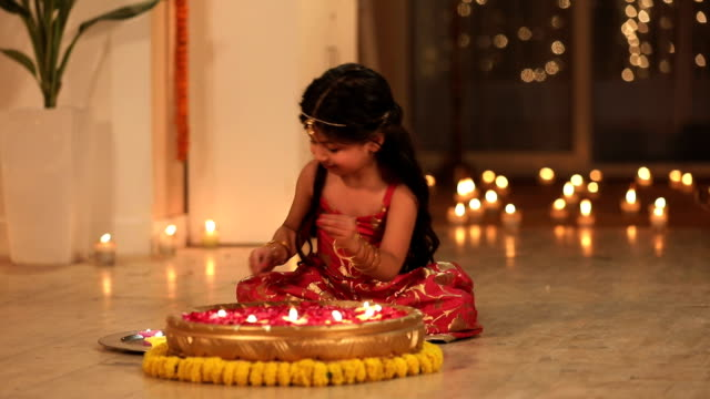 girl celebrating diwali festival in the home, delhi, india - votive candle stock videos and b-roll footage