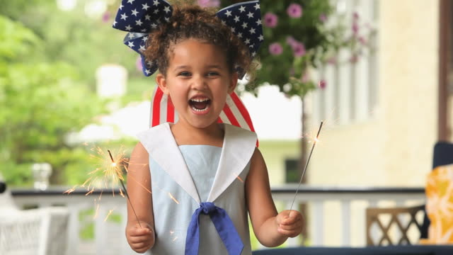 cu girl (4-5) celebrating independence day with sparklers / richmond, virginia, usa - fourth of july stock videos & royalty-free footage