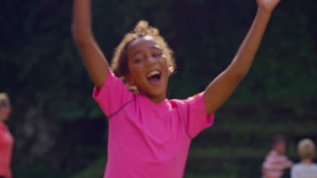 girl celebrating the win while playing soccer on a sunny day - girls stock videos & royalty-free footage