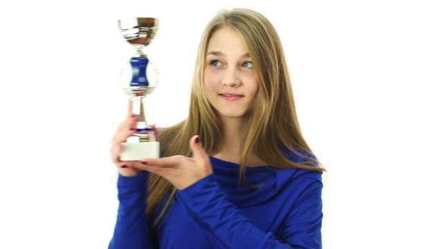 girl celebrating with trophy in hands