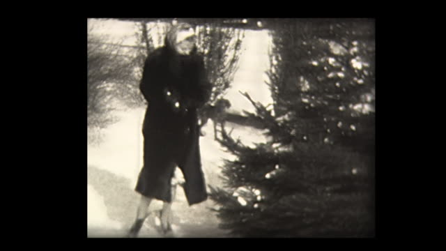 1940 girl chases mom around a tree with dog - family tree stock videos and b-roll footage