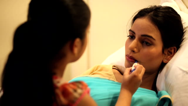 girl checking mothers temperature, delhi, india - black hair stock videos & royalty-free footage
