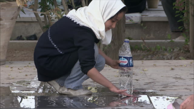 ms tu girl cleaning tombstone at iraq war cemetery, esfahan, iran - iran stock videos & royalty-free footage