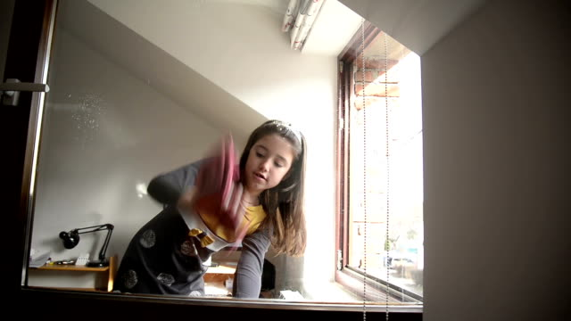 girl cleaning window - chores stock videos & royalty-free footage