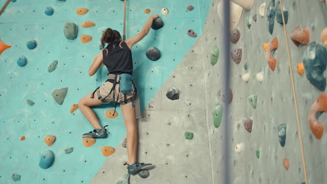 girl climbing in a climbing gym - recreational pursuit stock videos & royalty-free footage