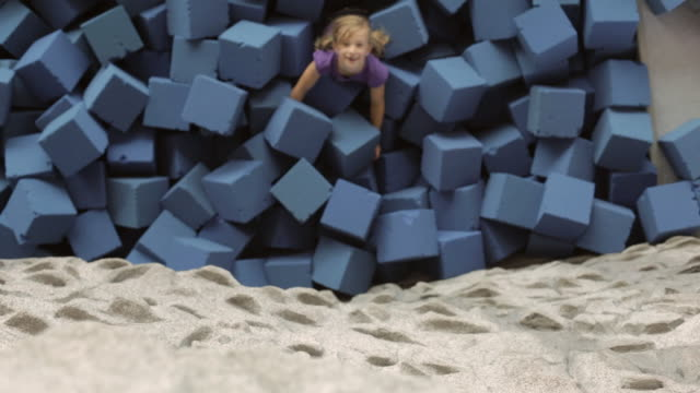ws girl climbing rock wall and falling onto foam blocks / vancouver, british columbia, canada - climbing wall stock videos & royalty-free footage