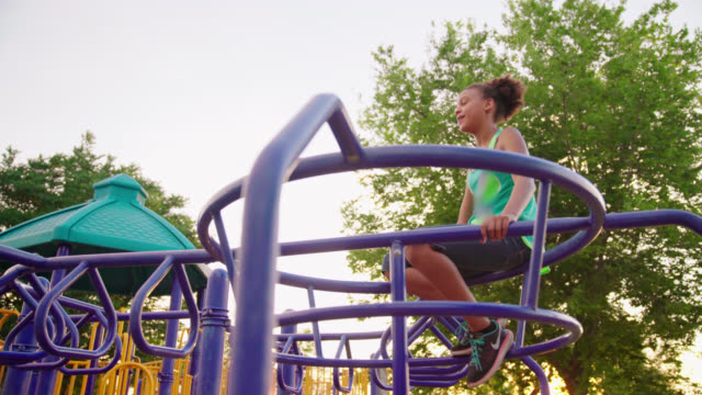 Girl Climbs Jungle Gym