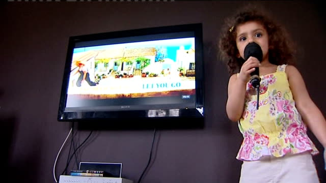 girl comes out of coma singing songs from mamma mia layla towsey singing along to film on karaoke machine - mamma mia stock videos and b-roll footage