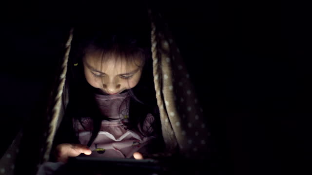 a girl concentrated with a tablet - one baby girl only stock videos & royalty-free footage