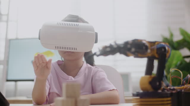 girl control robot arm on vr glasses, getting a lesson in robotics in high school - control stock videos & royalty-free footage