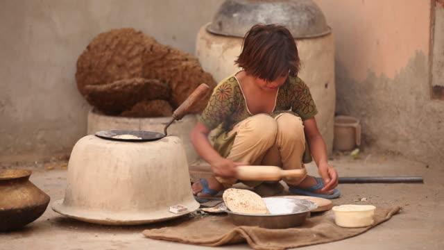 Girl cooking, Faridabad, Haryana, India
