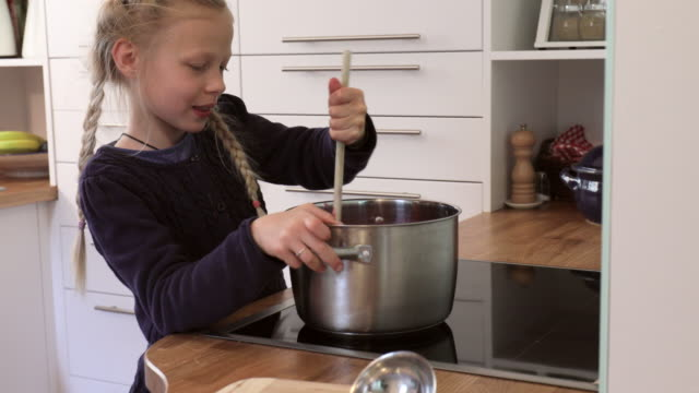 cu girl cooking jam, tracking in, selective focus - kreativität stock-videos und b-roll-filmmaterial