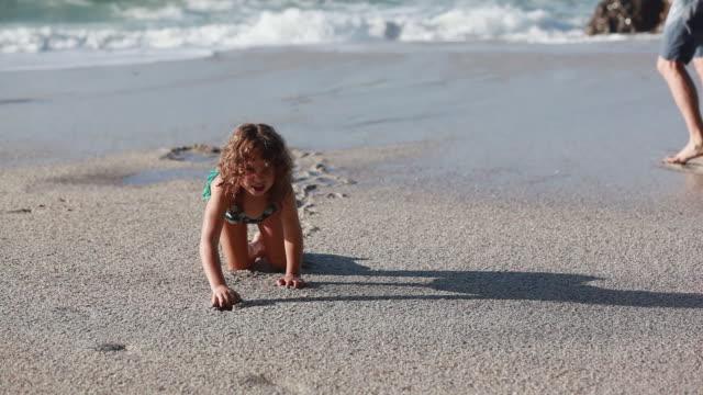 ms ts girl crawls on beach toward then turns around and crawls away / montezuma, puntarenas, costa rica - kelly mason videos stock videos & royalty-free footage