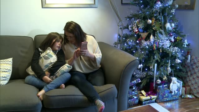 girl cured of rare kidney disease to spend first christmas at home in four years; england: int kitty skrabski chatting with debbie skrabski sot. - human kidney点の映像素材/bロール
