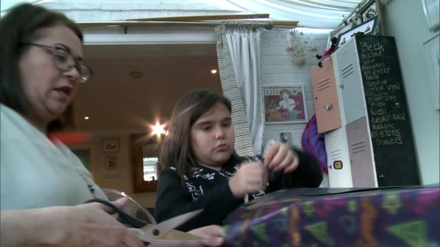 girl cured of rare kidney disease to spend first christmas at home in four years; uk; kitty skrabski writing christmas cards and interview. england:... - human kidney点の映像素材/bロール