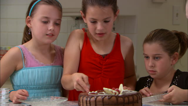 cu, girl (10-11) cutting and serving birthday cake to friends - birthday cake stock videos and b-roll footage