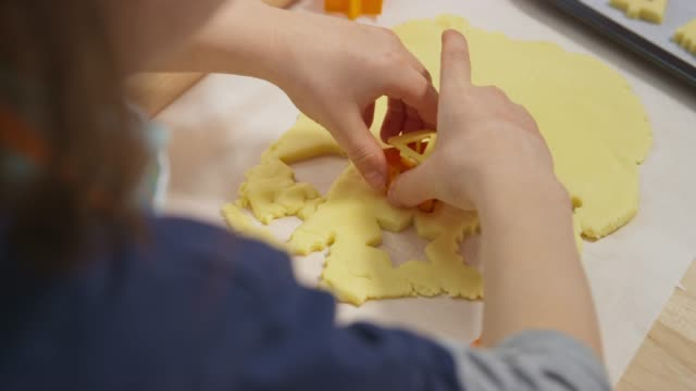 girl cutting cookies and placing them onto the baking tray - baking tray stock videos & royalty-free footage