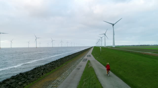 girl cycling - wind power stock videos & royalty-free footage