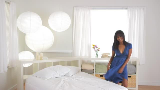 girl dancing in bedroom