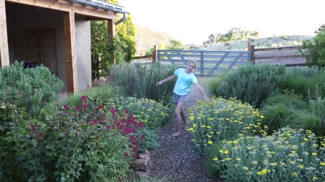 girl dancing in garden