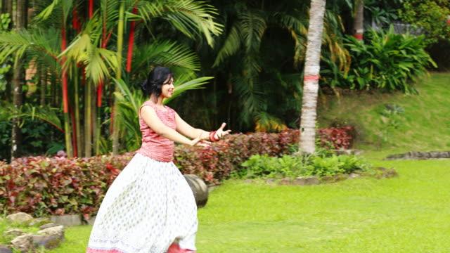 Girl Dancing in the Garden