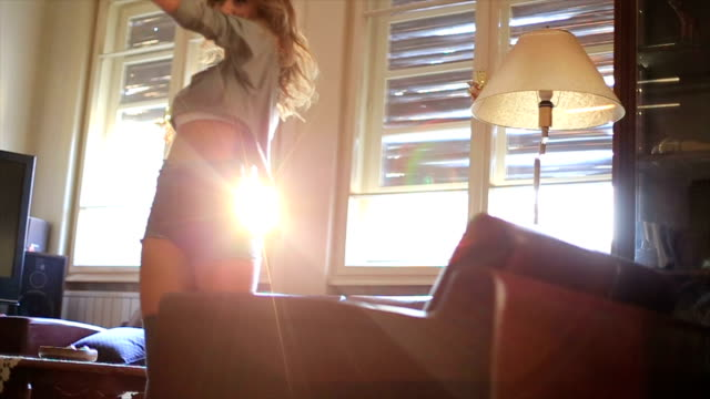 girl dancing in the house bathed in sunshine! - knee highs stock videos and b-roll footage