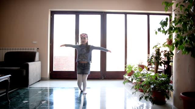 Girl dancing in the room.