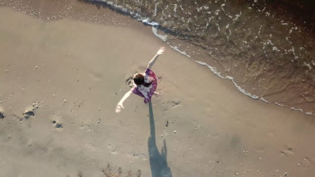 girl dancing on the beach - footprint stock videos and b-roll footage