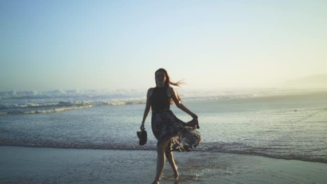 girl dancing on the beach - costume da bagno video stock e b–roll