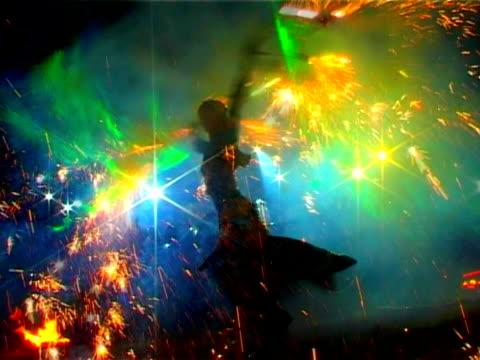 Girl dancing with fireballs