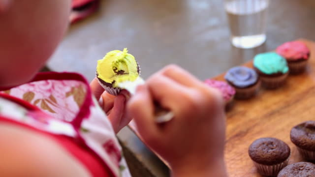 CU Girl decorating cupcakes / Lamy, New Mexico, United States