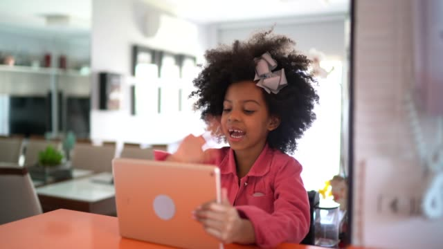 girl doing a video call on digital tablet at home - long distance relationship stock videos & royalty-free footage