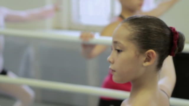 girl doing ballet exercise at barre - barre stock videos and b-roll footage
