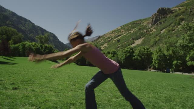 girl doing cartwheels  - cartwheel stock videos & royalty-free footage