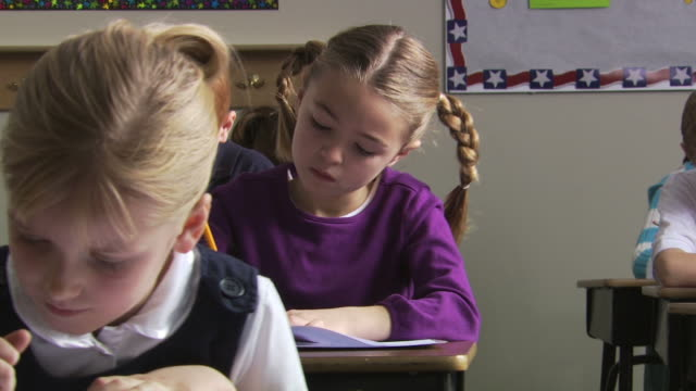 girl doing classwork - see other clips from this shoot 1148 stock videos & royalty-free footage