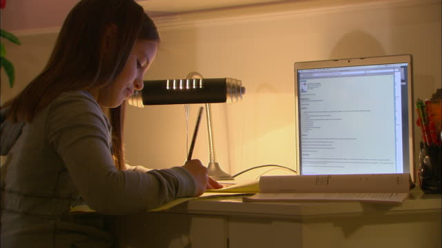 cu, girl (10-11) doing homework at desk, using laptop - 10 11 jahre stock-videos und b-roll-filmmaterial