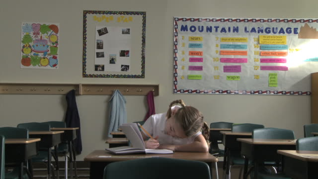 girl doing homework at school - see other clips from this shoot 1148 stock videos & royalty-free footage